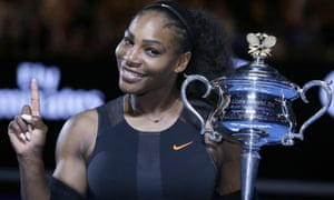 Serena Williams holds the Australian Open trophy she won this year