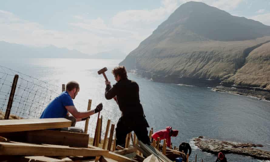Maintenance crew volunteers erecting a fence in Eysturoy, Faroe Islands in April 2019.