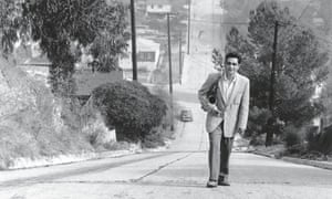 Art Pepper climbing the hill on Fargo Street in Los Angeles near his home.