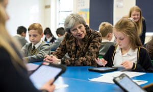 Theresa May sits with pupils during a visit to Brooklands Primary School in Sale, near Manchester.