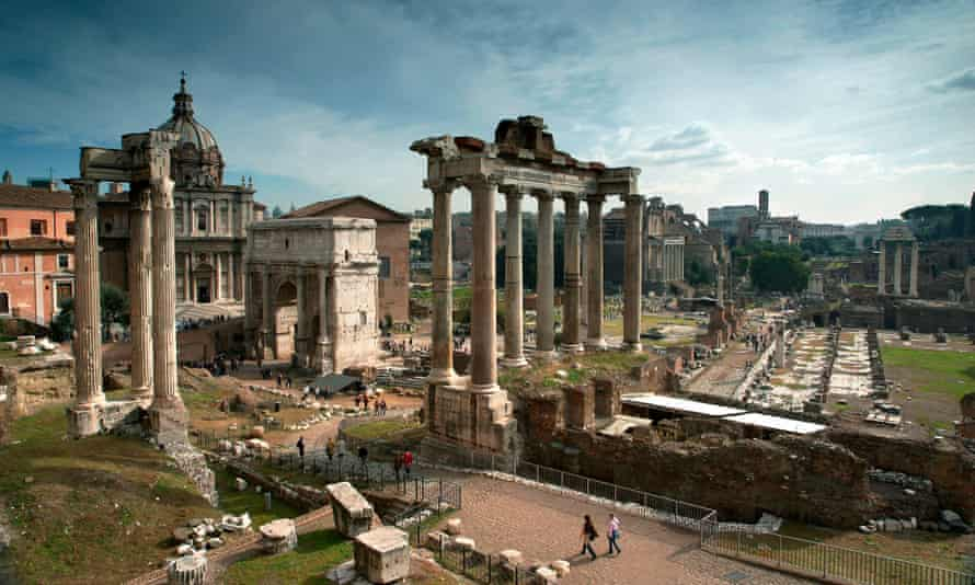 Tourists stroll through the heart of the remains of the Forum, Rome. An audit of properties owned by the city has shown some in prime areas are being rented out for just a few dollars a month.