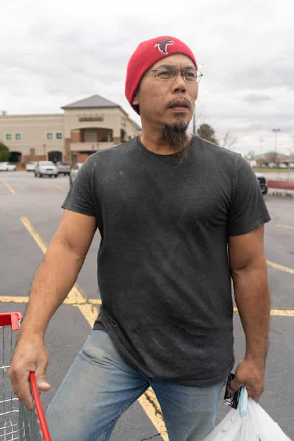 Sack Wichaisack, 47, Laotian-American who owns a construction company, shopping at an H-Mart in Suwanee, GA.