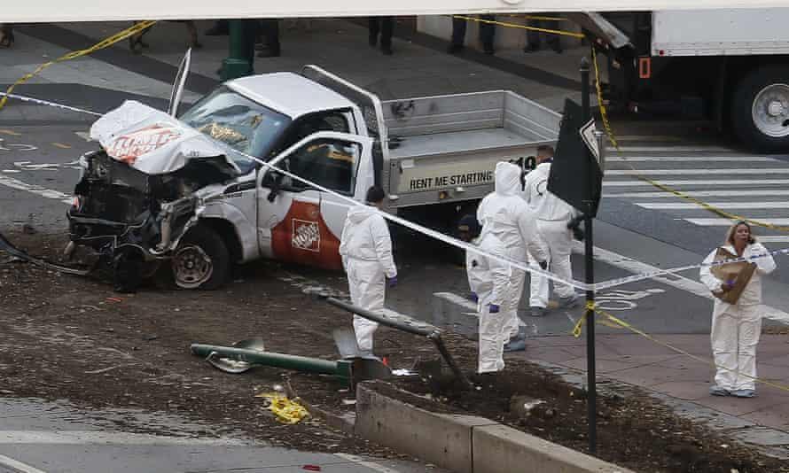 Authorities stand near a damaged Home Depot truck after a motorist drove onto a bike path near the World Trade Center memorial in New York.