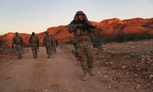 A civilian militia patrols the Mexican border