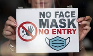A shop window in Newport, Wales, last week, where people must wear face mask in shops and other indoor public spaces.