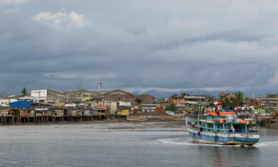A boat loaded with supplies heads out to sea in Buenaventura, Colombia's largest Pacific port and home to a small Muslim community.