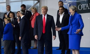 Donald Trump and Theresa May take part in the family photo at the Nato Summit.