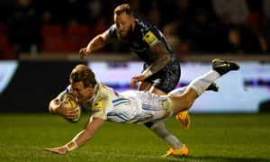 Lachie Turner scores a try for Exeter past Byron McGuigan of Sale during the Premiership match.