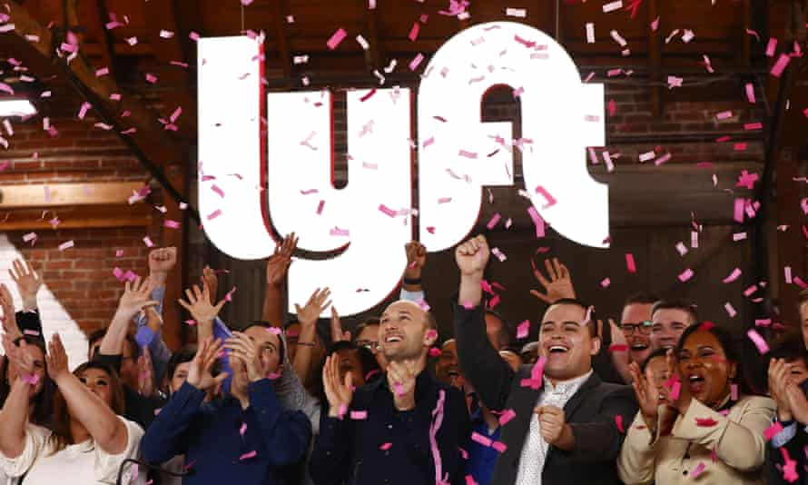 Confetti falls as Lyft executives ring the Nasdaq opening bell to celebrate the company's IPO.