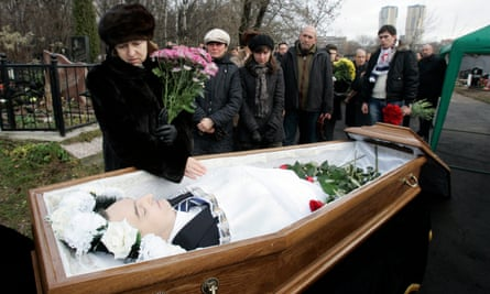 Magnitsky's wife with her husband's body during his funeral in Moscow, 2009.