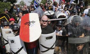 White nationalist demonstrators use shields as they guard the entrance to Lee Park in Charlottesville, Virginia, on Saturday.