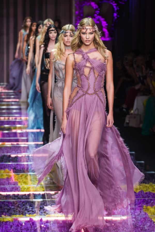 Models wear creations from Italian fashion designer Donatella Versace's fall-winter collection.