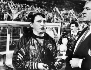 Lawrie McMenemy comforts Graham Taylor after the final whistle after the Netherlands' 2-0 victory that all but ensured England missed out on qualifying for the 1994 World Cup.