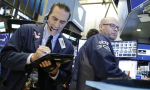 Traders work on the floor of the New York Stock Exchange on Wall Street.