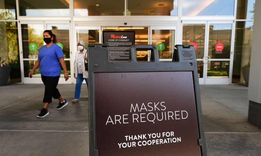 A shopping mall in southern California reminds patrons to wear face masks as the state reopens businesses.