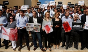 Journalists in Valletta, Malta, protest against the murder of investigative journalist Daphne Caruana Galizia