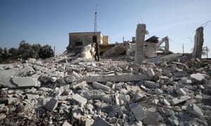 A man in the ruins of a house following an air strike by pro-regime forces in the village of Sheikh Ahmad, on the Damascus-Aleppo Highway, December 2019.