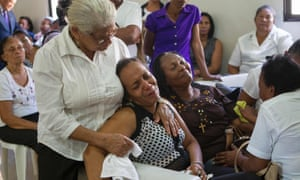 Relatives of broadcaster Luis Manuel Medina mourn during his wake in the municipality of Consuelo, San Pedro de Macorís province, Dominican Republic.