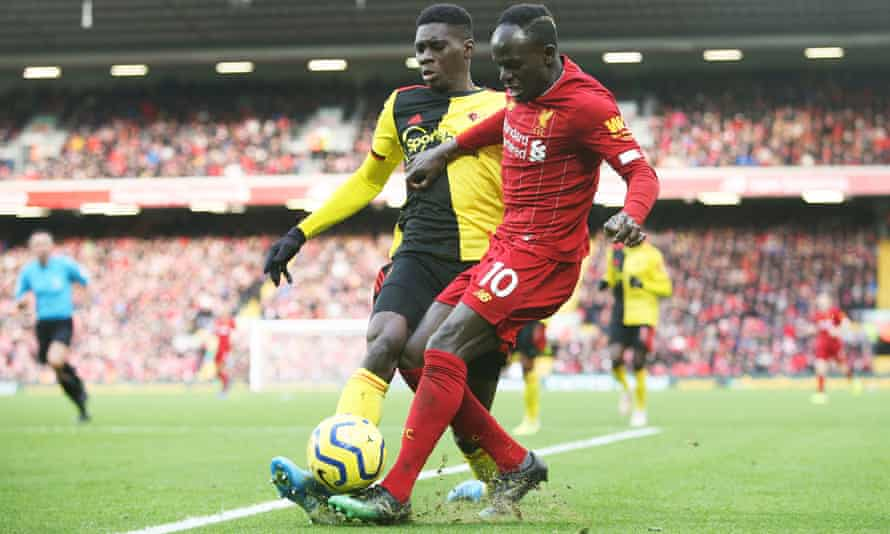 Ismaïla Sarr tackles Sadio Mané during Watford's 2-0 defeat at Liverpool. The young winger has played a key role in Watford's resurgence.