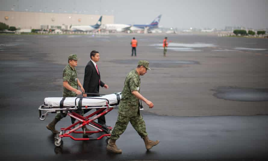Soldiers in Mexico city prepare for the arrival of Mexican tourists injured in Egypt, who arrived on a flight on Friday.