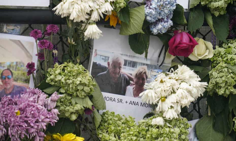 A memorial wall for the victims of the Champlain Towers South building collapse in Surfside, Florida, displays a photo of Juan Mora Sr and his wife, Ana Mora.