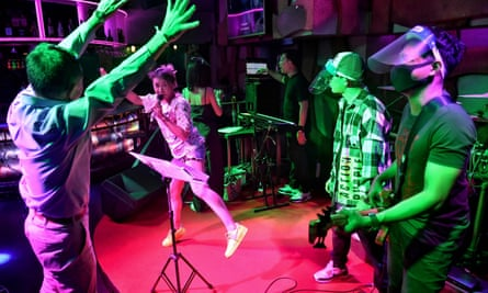 A band plays for a customer in a near-empty bar in the Patpong area of the city.