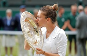Halep poses with the spoils of her victory.
