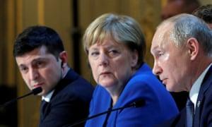 Volodymyr Zelenskiy, left, with Angela Merkel and Vladimir Putin during talks in Paris in December.