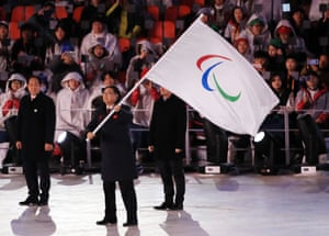 The Mayor of Beijing Chen Jining waves the Paralympic flag during the Closing Ceremony for the PyeongChang 2018 Winter Paralympics in South Korea
