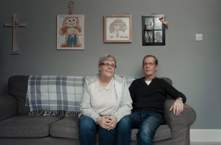 Jan and Colin Smith, in front of pictures by their son Colin, a haemophiliac who was given contaminated blood and died aged seven
