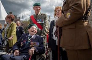 British veteran laughing along with a serving Briitish Army Warrant officer during the slow march from the Bayeux Cathedral to the Commonwealth War Graves cemetery in Bayeux