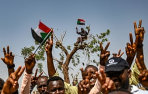 Protestors chant slogans and flash victory signs during a protest outside the army complex in Khartoum. Sudanese protesters hardened their demand that the military men in power quickly step down and make way for civilian rule, refusing to budge from their sit-in outside army headquarters.