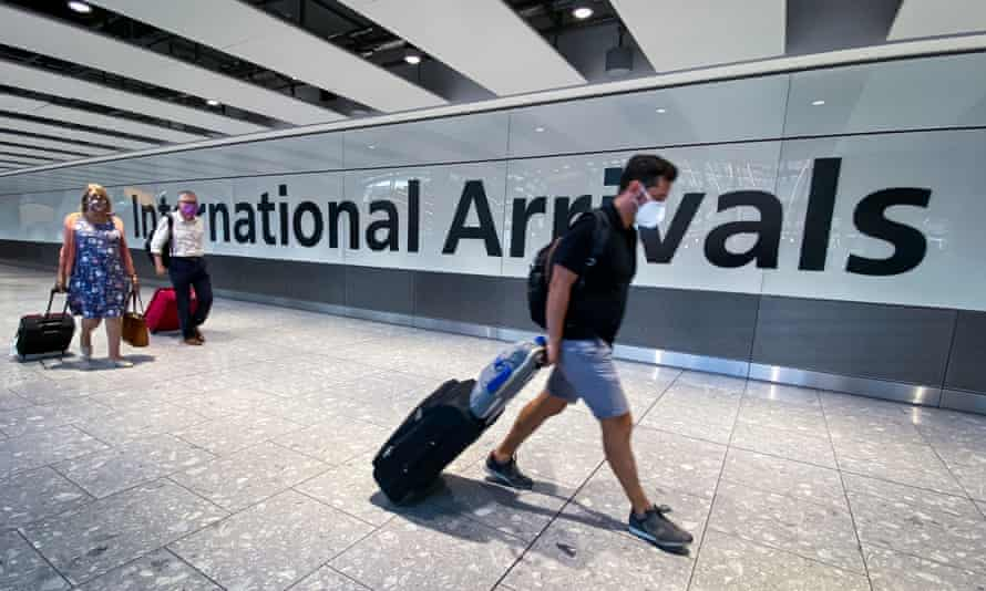 Passengers in the arrivals hall at Heathrow Airport, London