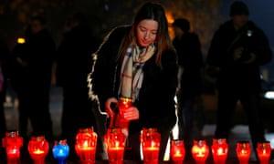 A woman lights a candle in tribute to Slobodan Praljak in Mostar, Bosnia-Herzegovina.