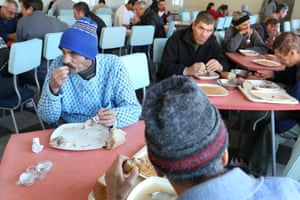 TB patients who are smear-negative (no longer contagious) eat lunch at Bisericani hospital canteen.
