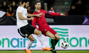 Ali Gabr vies with Cristiano Ronaldo during Egypt's friendly with Portugal last week, in which the Real Madrid star scored twice.