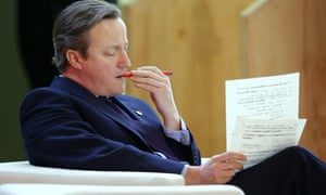 The British prime minister, David Cameron, goes over some paperwork prior to addressing world leaders at COP21.
