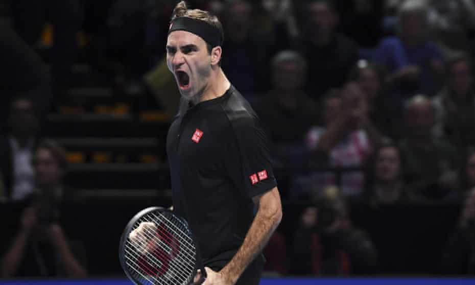 Roger Federer celebrates winning match point.