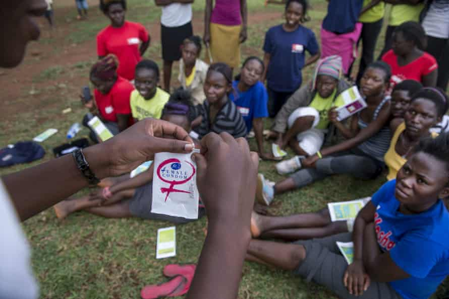 An outreach worker in Uganda raises awareness about family planning and sex education.