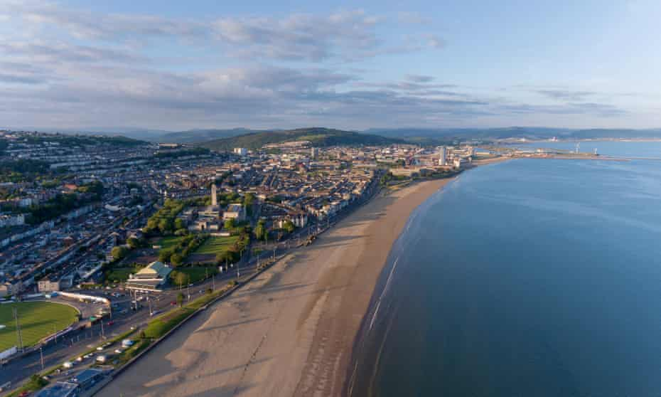 An aerial view of Swansea Bay, South Wales, UK, showing Victoria Park to the city centre