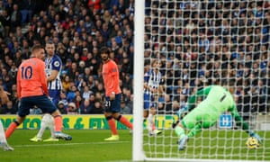 Brighton and Hove Albion's keeper Mathew Ryan makes a save from Everton's Andre Gomes.