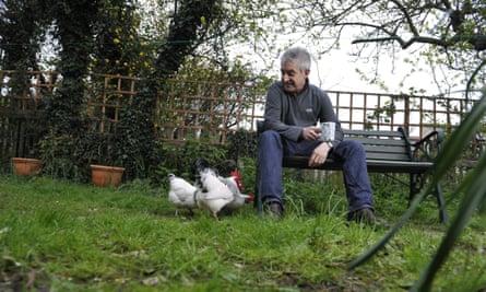 Tony Juniper at home in his garden.