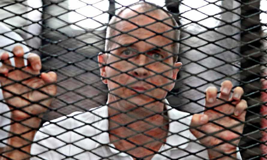 Peter Greste awaiting sentence in Cairo in June last year