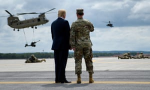 US President Donald Trump (L) watches an air assault exercise with Army Major General Walter Piatt at Fort Drum, New York