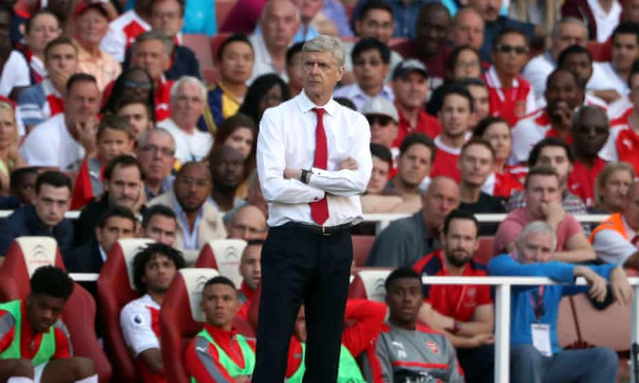 Arsène Wenger watches his Arsenal team slump to a 4-3 defeat against Liverpool at the Emirates on the opening day of the season.