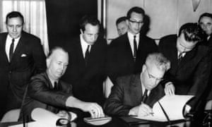United States representative N. Stelle (L) and his Soviet Union counterpart M. Tsarapkin (R) sign an agreement to set up a hot line communications link between the two superpowers, Geneva, 20 June 1963.