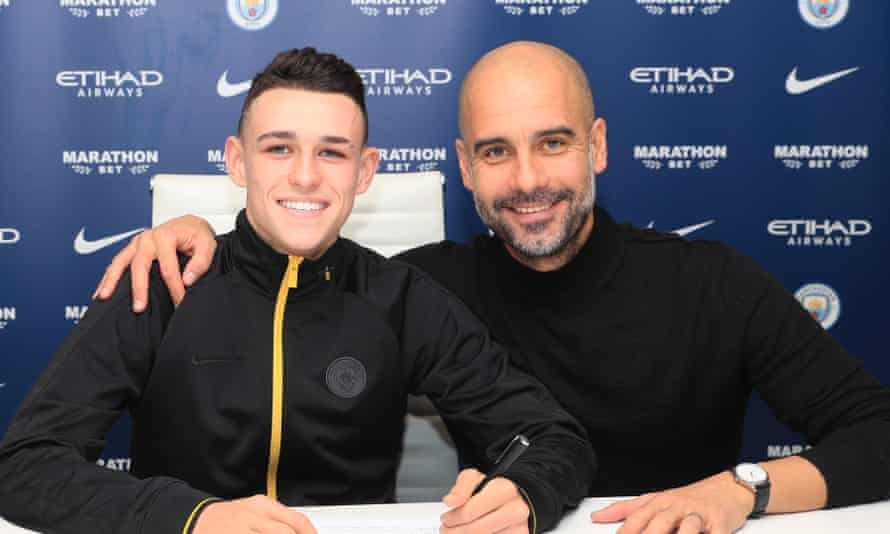 Phil Foden signs a contract extension last year