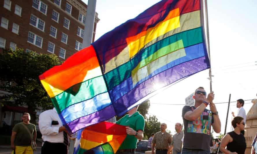 Supporters applaud Barack Obama's support for gay marriage in Dallas in 2012.