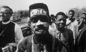 Selma, Alabama, 1965: 'Vote' written across the forehead of a young man marching for black voting rights.