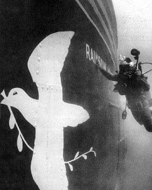 A diver photographing the sunken Rainbow Warrior in July 1985 after it had been bombed by French secret service agents.